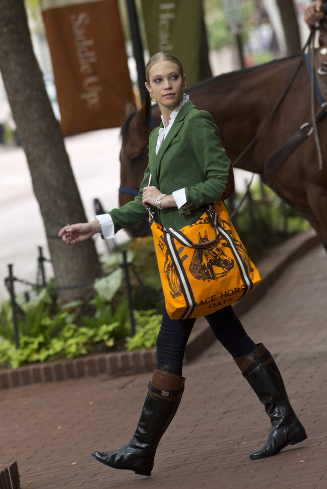 Dressage meets downtown with a new crop of clothes, bags and baubles inspired by the riding life. Roxanna Redfoot models equestrian style. (Ross Hailey/Fort Worth Star-Telegram/MCT)