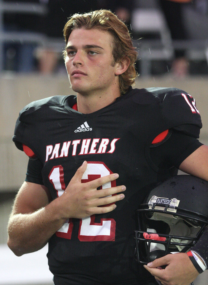 HIGH SCHOOL FOOTBALL: Colleyville Heritage senior quarterback Cody Thomas (12) during the playing of the national anthem before the start of his team\'s game against Flower Mound at Pennington Field on Friday, September 14, 2012. (Kelley Chinn/Special Contributor) ORG XMIT: DMN1209142151192011