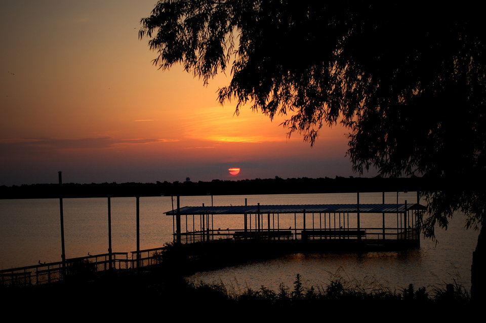 Dawning of a new day over the fishing dock at Lake Overholser.<br/><b>Community Photo By:</b> Eldon Harris<br/><b>Submitted By:</b> Eldon, Bethany
