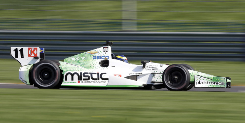 Photo - Sebastien Bourdais, of France, speeds through a turn during practice for the inaugural Grand Prix of Indianapolis IndyCar auto race at the Indianapolis Motor Speedway in Indianapolis, Thursday, May 8, 2014. (AP Photo/Michael Conroy)