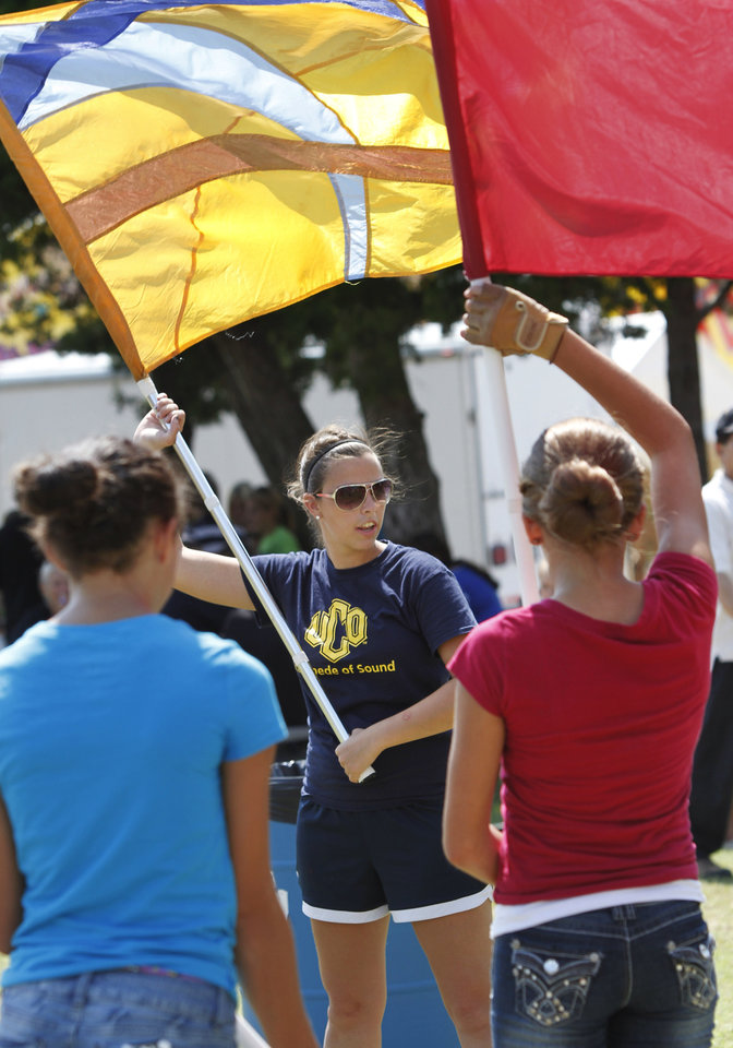 Abbey Rayborn (cq), a sophomore at UCO, conducts a clinic for high school color guards during Band Day at the state fair on Monday, Sep. 17, 2012,  Rayborn is a member of the UCO Color guard. Photo by Jim Beckel, The Oklahoman.