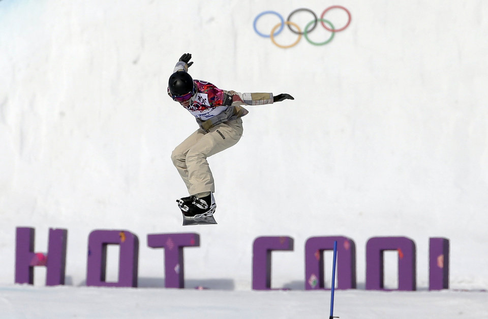 Photo - Lindsey Jacobellis of the United States takes a jump in her seeding run during women's snowboard cross competition at the Rosa Khutor Extreme Park, at the 2014 Winter Olympics, Sunday, Feb. 16, 2014, in Krasnaya Polyana, Russia. (AP Photo/Andy Wong)