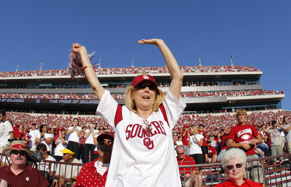Photo - Sooner fan Karen Acker, of Norman, cheers on her team before the start of the University of Oklahoma Sooners (OU) college football game against the University of North Texas Mean Green (UNT) at the Gaylord Family - Oklahoma Memorial Stadium, on Saturday, Sept. 1, 2007, in Norman, Okla.