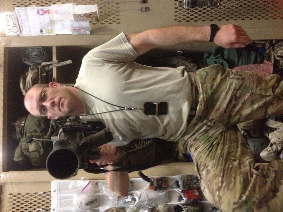 Photo -  Former Airborne Ranger and soon-to-be Oklahoma City oil law attorney Matt Meloni with the weapon he trained with, an M3 Carl Gustav. [Photo provided]