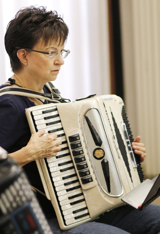 Photo -  Maggie Abel practices her accordion. Photo by Doug Hoke, The Oklahoman   DOUG HOKE