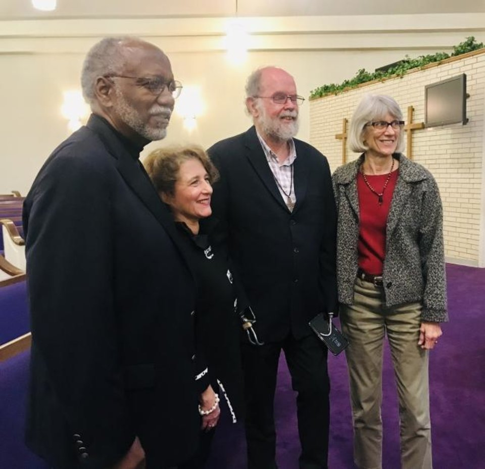 Photo -  Oscar Jackson, Shannon Warren, South African Anglican priest Michael Lapsley and Janie Kirt Morris pose for a picture after Lapsley's talk on Monday at Fairview Baptist Church in northeast Oklahoma City. [Carla Hinton/The Oklahoman]