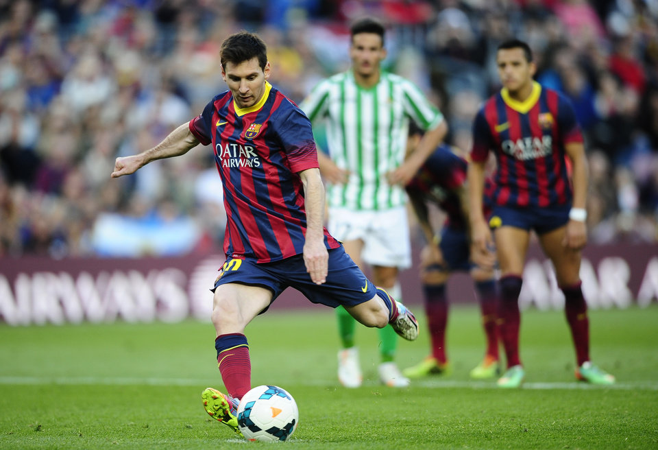 Photo - FC Barcelona's Lionel Messi kicks the ball for a penalty during a Spanish La Liga soccer match against Betis at the Camp Nou stadium in Barcelona, Spain, Saturday, April 5, 2014. (AP Photo/Manu Fernandez)