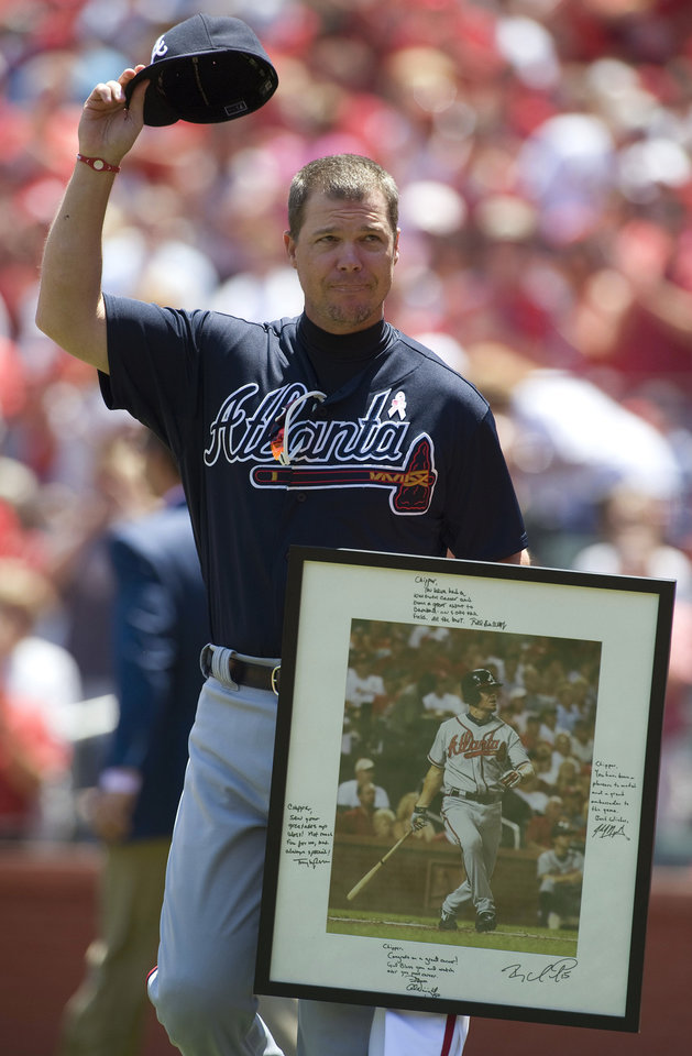 Atlanta Braves third baseman Chipper Jones waves to fans after being honored by the St. Louis Cardinals on his upcoming retirement, before a baseball game Sunday, May 13, 2012, in St. Louis. The 40-year-old Jones, who is retiring after this year, got a rousing ovation from a packed crowd during the ceremony. He got a standing ovation before his first at-bat on Friday. (AP Photo/Jeff Curry)