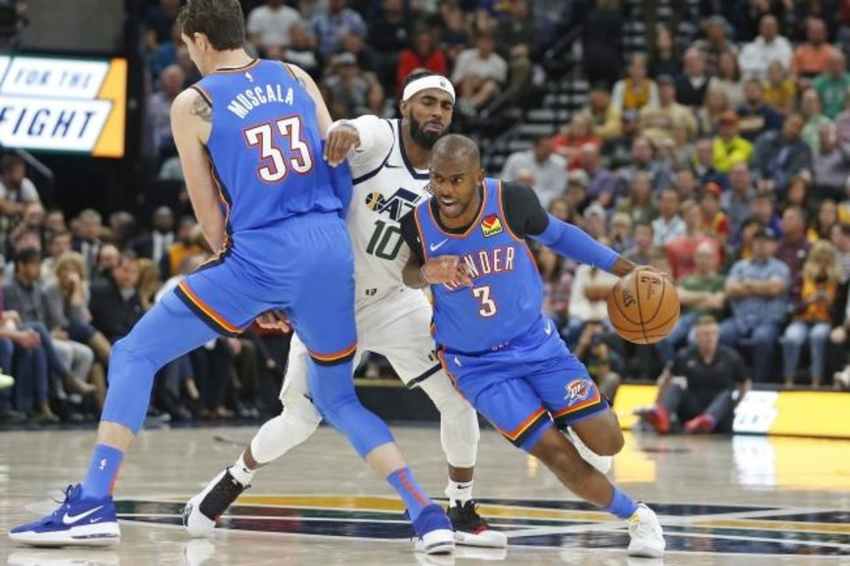Photo -  Oklahoma City Thunder forward Mike Muscala fouls Utah Jazz guard Mike Conley as Thunder guard Chris Paul drives during Wednesday night's game in Salt Lake City. [AP Photo/Rick Bowmer]
