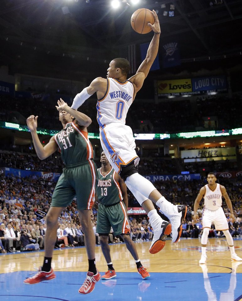 Oklahoma City\'s Russell Westbrook (0) drives to the basket past Milwaukee \'s John Henson (31) during the season finally NBA basketball game between the Oklahoma City Thunder and the Milwaukee Bucks at Chesapeake Energy Arena on Wednesday, April 17, 2013, in Oklahoma City, Okla. Photo by Chris Landsberger, The Oklahoman