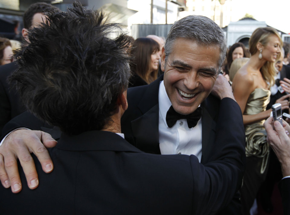 Brian Grazer, left, producer of the 84th Academy Awards, and George Clooney arrive at the 84th Academy Awards on Sunday, Feb. 26, 2012, in the Hollywood section of Los Angeles. (AP Photo/Chris Carlson) ORG XMIT: OSC229