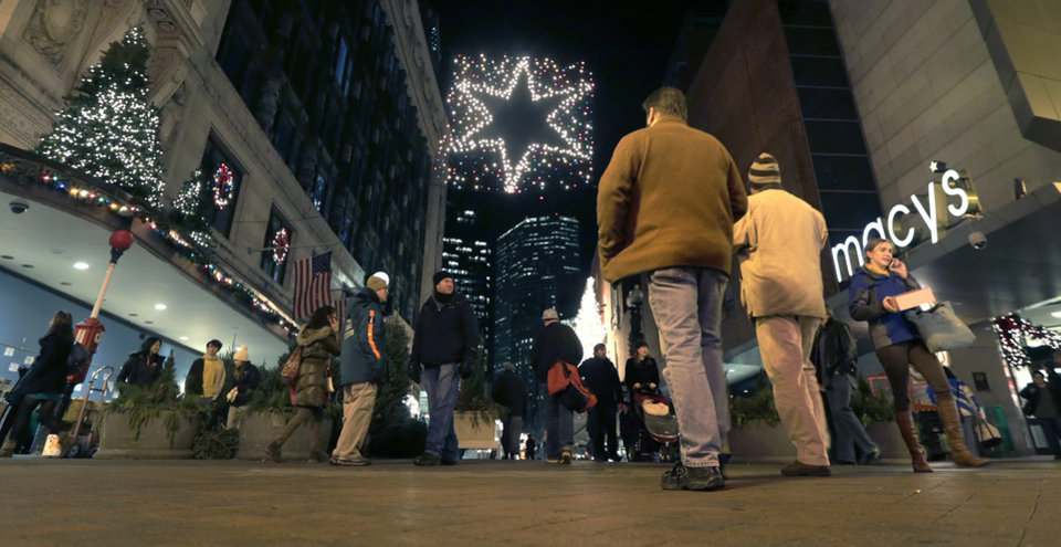 In this Thursday, Dec. 13, 2012 photo, shoppers walk past holiday decorations at the Downtown Crossing in Boston. After a promising start to the holiday shopping season over the four-day Thanksgiving weekend, sales have slowed, according to an analysis of data done for The Associated Press by sales tracker ShopperTrak. Worries about weak U.S. job growth and other concerns are likely to blame for Americans spending less. That puts pressure on J.C. Penney, Macy's and other stores, which had been offering fewer discounts this season than they did last year, to step up promotions to lure shoppers. (AP Photo/Charles Krupa)