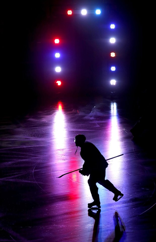 A Barons player takes the ice before an AHL hockey game at the Cox Convention Center in Oklahoma City, Tuesday, October 23, 2012. Photo by Bryan Terry, The Oklahoman