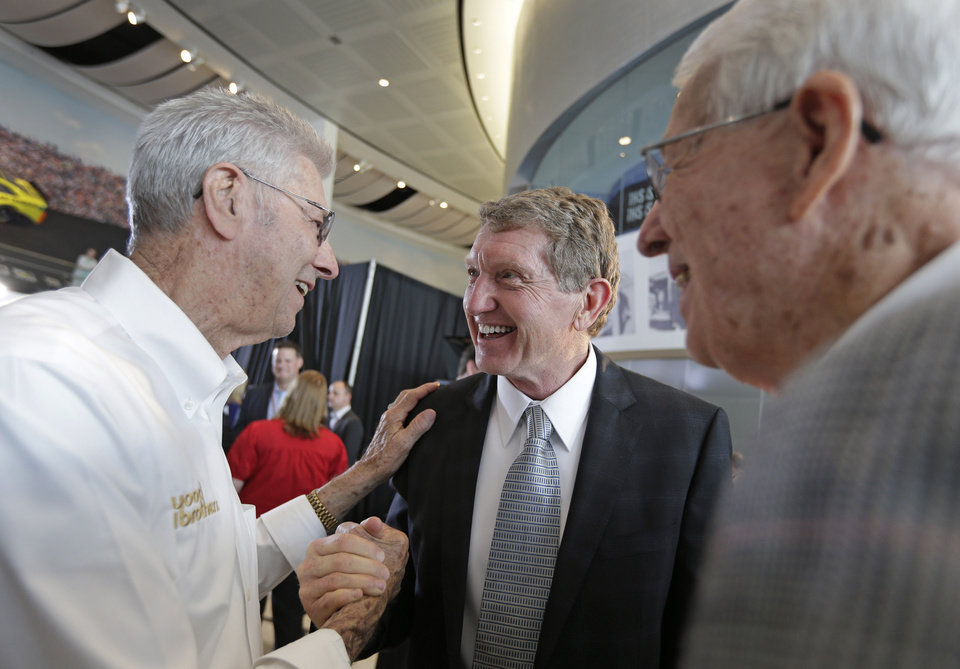 Photo - Bill Elliott, center, is congratulated by Leonard Wood, left, and Glen Wood after being named as one of five inductees into the NASCAR Hall of Fame class of 2015, in Charlotte, N.C., Wednesday, May 21, 2014. (AP Photo/Chuck Burton)