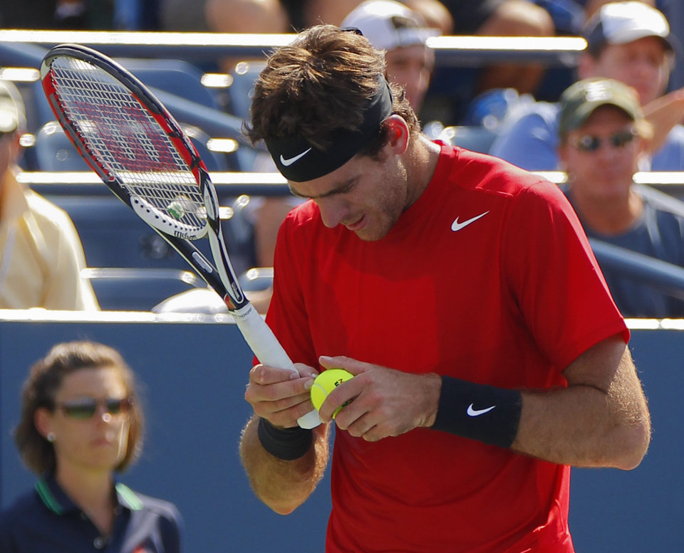 Photo -   Argentina's Juan Martin Del Potro observes a ball to serve to Ryan Harrison in the third round of play at the 2012 US Open tennis tournament, Friday, Aug. 31, 2012, in New York. (AP Photo/Paul Bereswill)