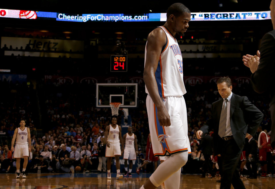 Oklahoma City\'s Kevin Durant (35) walks off the court beside coach Scott Brooks during an NBA basketball game between the Oklahoma City Thunder and the Miami Heat at Chesapeake Energy Arena in Oklahoma City, Thursday, Feb. 15, 2013. Photo by Bryan Terry, The Oklahoman