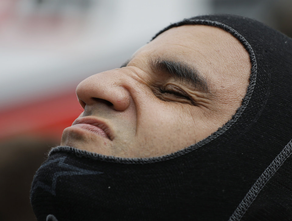 Photo - Juan Pablo Montoya, of Colombia, puts on his balaclava before practicing for Indianapolis 500 IndyCar auto race at the Indianapolis Motor Speedway in Indianapolis, Monday, May 12, 2014. (AP Photo/Darron Cummings)