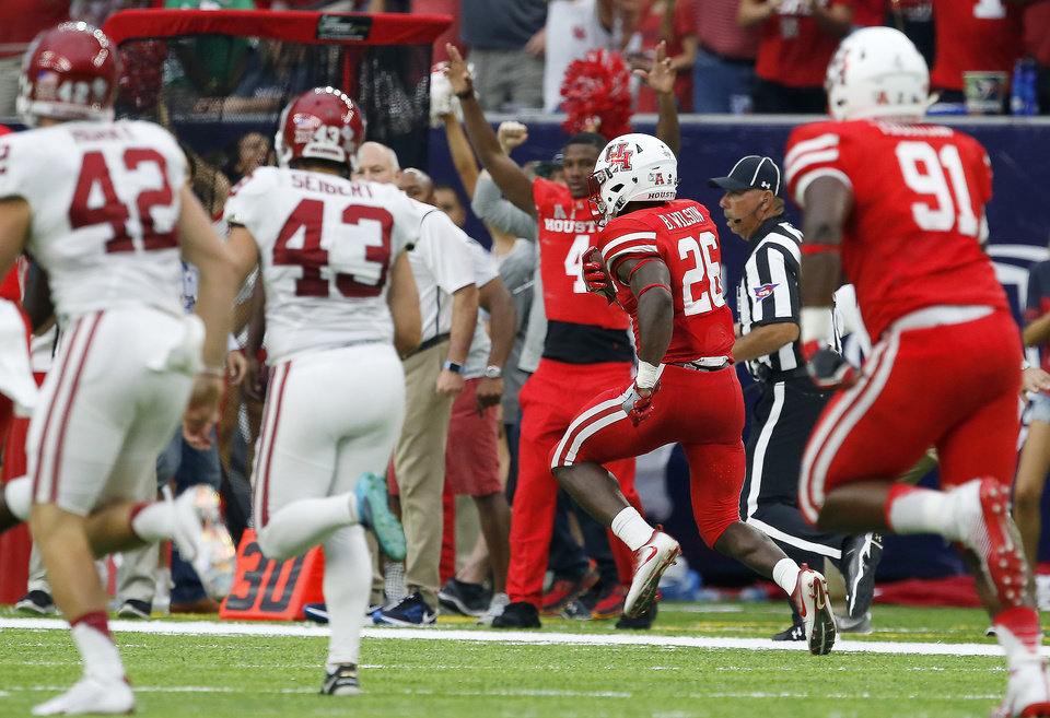 Photo - Houston's Brandon Wilson (26) returns a missed field goal for a touchdown during the AdvoCare Texas Kickoff college football game between the University of Oklahoma Sooners (OU) and the Houston Cougars at NRG Stadium in Houston, Saturday, Sept. 3, 2016. Houston won 33-23. Photo by Bryan Terry, The Oklahoman