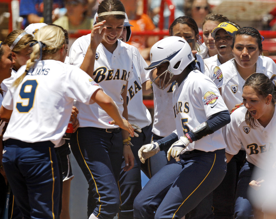 Photo - California's Elia Reid (5) celebrates with teammates after hitting a home run in the sixth inning during a Women's College World Series softball game between Oklahoma State University and California at ASA Hall of Fame Stadium in Oklahoma City, Saturday, June 4, 2011. California won, 6-2. Photo by Bryan Terry, The Oklahoman