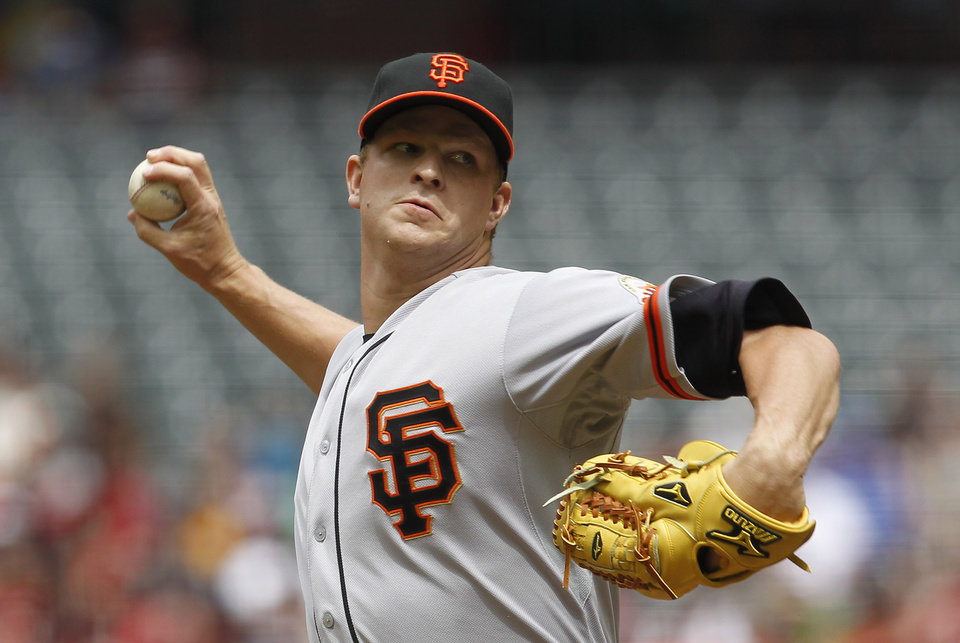 Photo -   San Francisco Giants' Matt Cain throws against the Arizona Diamondbacks during the first inning in an MLB baseball game Sunday, April 8, 2012, in Phoenix.(AP Photo/Ross D. Franklin)