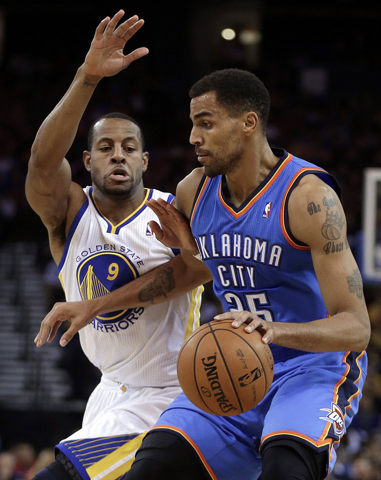 Oklahoma City Thunder's Thabo Sefolosha, right, drives the ball against Golden State Warriors' Andre Iguodala during the first half of an NBA basketball game Thursday, Nov. 14, 2013, in Oakland, Calif. (AP Photo/Ben Margot)