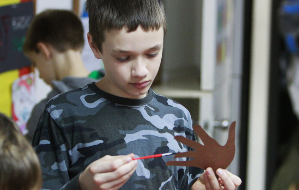 Jacob Weaver, 11, makes a Christmas decoration during the Before and After School Care program at the YMCA in Edmond, Thursday, December 22 , 2011.  Photo by David McDaniel, The Oklahoman