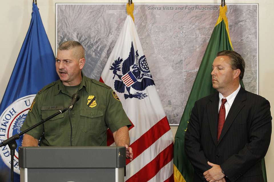 Photo -   Hours after a U.S. Border Patrol agent was shot and killed, and one other was shot and injured, Jeffrey Self, left, U.S. Border Protection Joint Field Command Arizona, issues a statement and James Turgal, FBI Special Agent in Charge Phoenix, listens during a news conference at the U.S. Customs and Border Protection Brian A. Terry Border Patrol Station Tuesday, Oct. 2, 2012, in Bisbee, Ariz.(AP Photo/Ross D. Franklin)