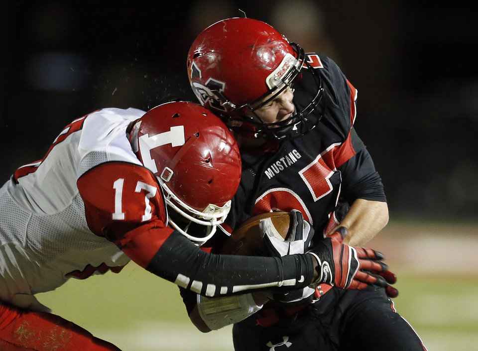 Lawton's Kalin Sadler tackles Mustang's Kale Harper during the high school football game between Mustang and Lawton at Mustang High School in Mustang, Okla., Friday, Oct. 26, 2012. Photo by Sarah Phipps, The Oklahoman