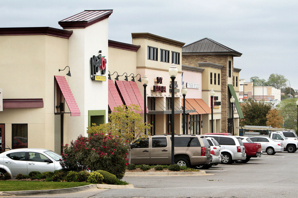 Photo - Moore Town Center, one of the booming retail developments in Moore. Photos by STEVE SISNEY, The Oklahoman