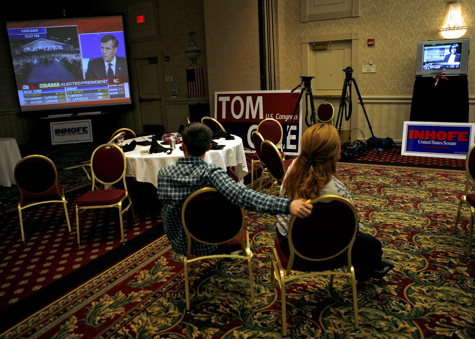 Photo - As the crowd at the Republican watch party in Oklahoma City starts to thin, two republican party supporters watch news that Barack Obama has been elected President on Tuesday Nov. 4, 2008. By John Clanton, The Oklahoman