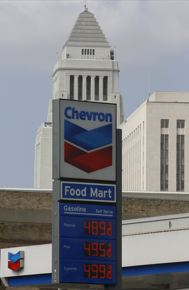 Photo - In this Thursday, Apr. 25, 2013, photo, the logo of Chevron is seen at a gas station downtown Los Angeles. Chevron Corp. reports quarterly financial results before the market opens on Friday, April 26, 2013. (AP Photo/Damian Dovarganes)