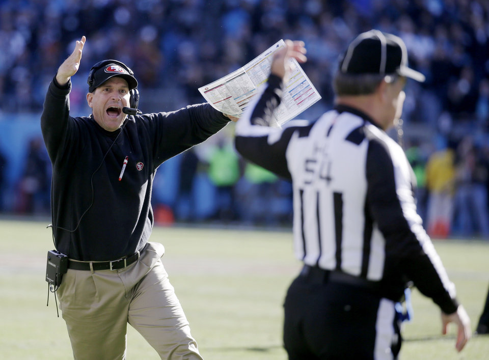 Photo - San Francisco 49ers head coach Jim Harbaugh reacts to a a call at the end of the first half against the Carolina Panthers during the first half of a divisional playoff NFL football game, Sunday, Jan. 12, 2014, in Charlotte, N.C. (AP Photo/John Bazemore)