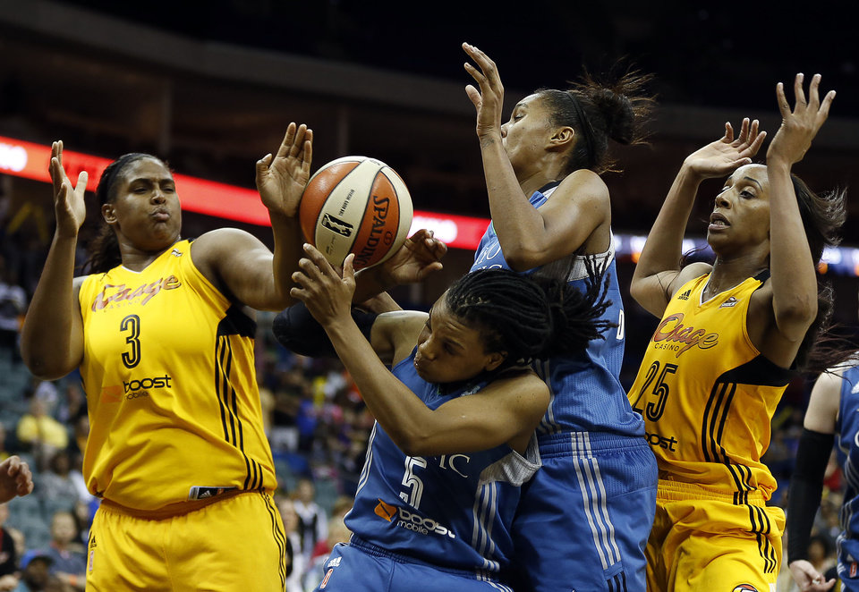 Photo - Tulsa's Courtney Paris (3) and Glory Johnson (25) battle for a rebound with Minnesota's Tan White (5) and Damiris Dantas (34), during the Shock-Lynx WNBA basketball game, at the BOK Center, on Friday, May 23, 2014. CORY YOUNG/Tulsa World