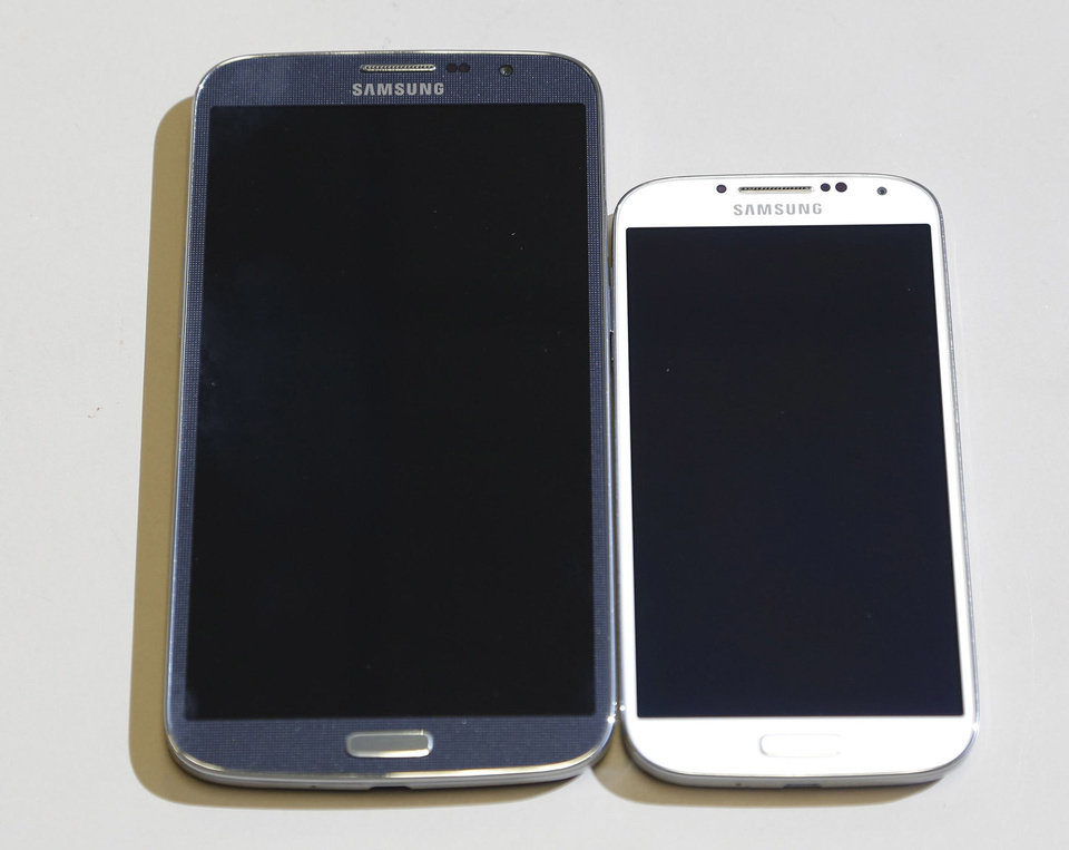 Photo - The Samsung Galaxy Mega sits to the right of the Samsung Galaxy S4. Photo by Doug Hoke, The Oklahoman  DOUG HOKE
