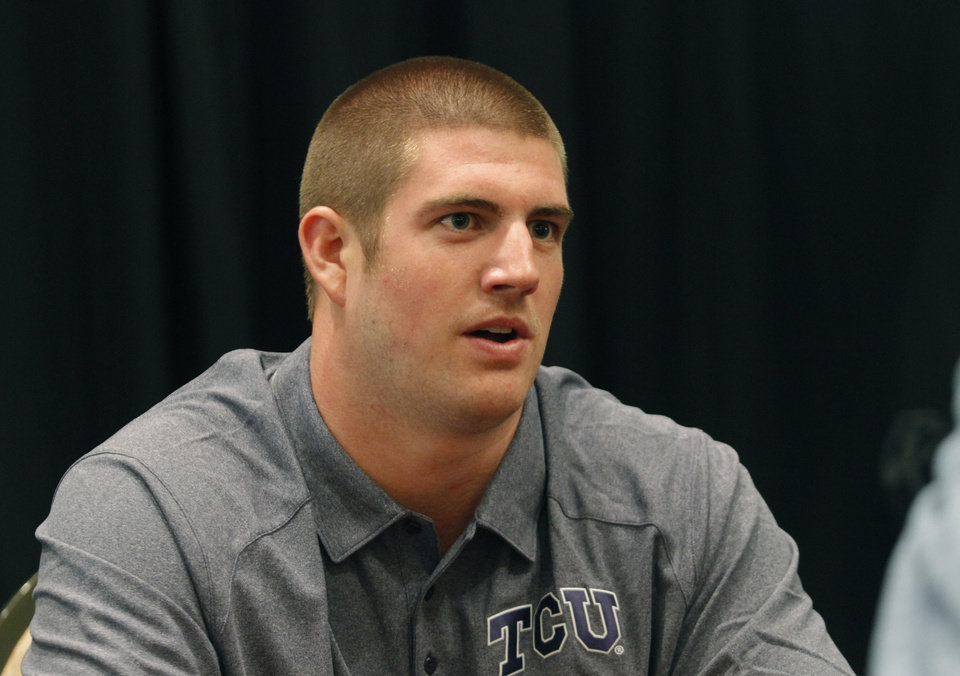 TCU defensive end Jon Koontz conducts interviews during a breakout session at the Big 12 Conference Football Media Days Monday, July 22, 2013 in Dallas. (AP Photo/Tim Sharp)