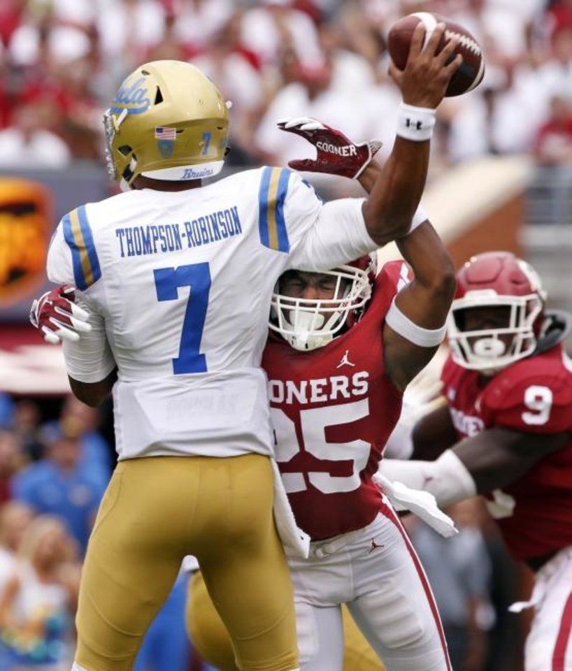 Photo -  The Sooners have had their way against UCLA historically, going 4-1. Justin Broiles (25) and Co. handed the Bruins a 49-21 loss last season. [Steve Sisney/The Oklahoman archives]