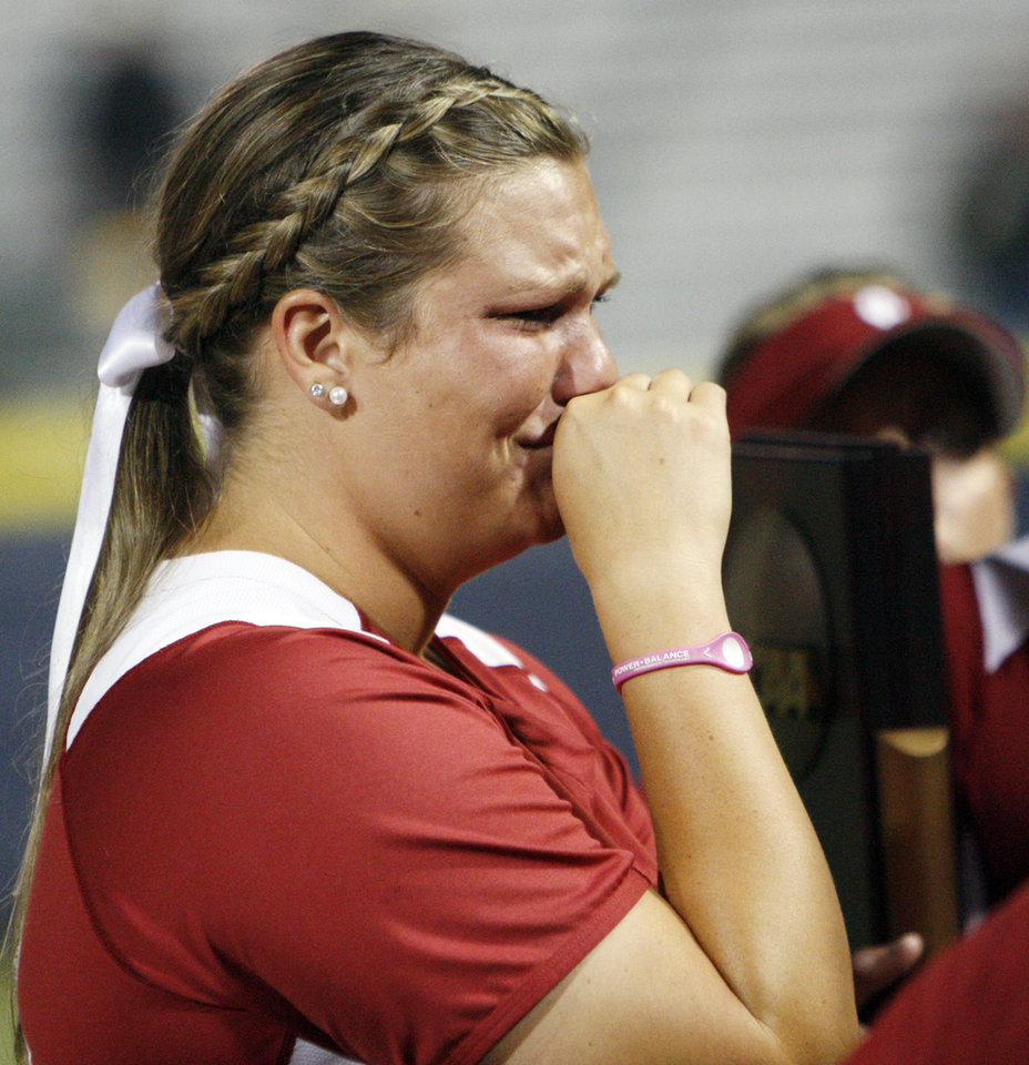 Photo - Oklahoma's Katie Norris (33) reacts after Game 3 of the Women's College World Series softball championship between OU and Alabama at ASA Hall of Fame Stadium in Oklahoma City, Wednesday, June 6, 2012. Alabama won the game, 5-4, and the championship. Photo by Nate Billings, The Oklahoman