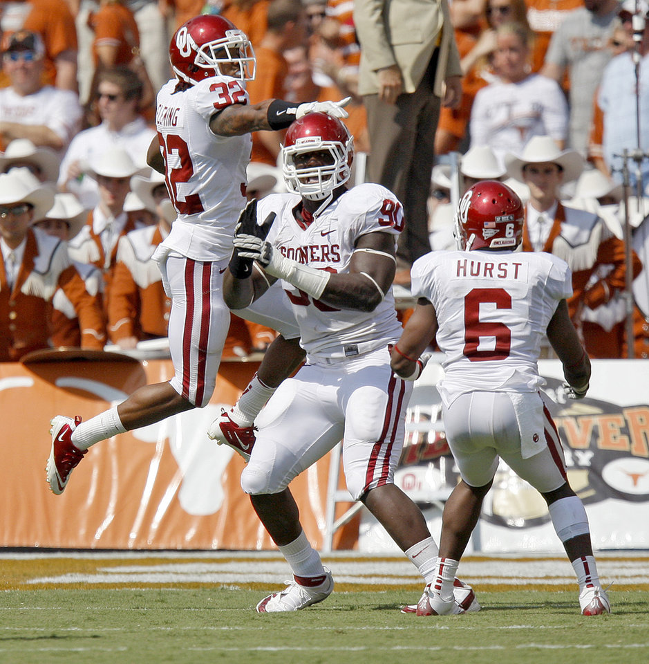 Oklahoma\'s David King (90), Jamell Fleming (32), and Demontre Hurst (6) celebrate after a fumble recovery for a touchdown during the Red River Rivalry college football game between the University of Oklahoma Sooners (OU) and the University of Texas Longhorns (UT) at the Cotton Bowl in Dallas, Saturday, Oct. 8, 2011. Oklahoma won 55-17. Photo by Bryan Terry, The Oklahoman