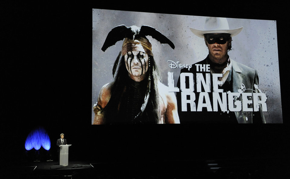 "A still photo from the upcoming film ""The Lone Ranger"" is displayed as Walt Disney Studios Chairman Alan Horn addresses the audience during the Walt Disney Studios presentation at CinemaCon 2013 at Caesars Palace on Wednesday, April 17, 2013 in Las Vegas. (Photo by Chris Pizzello/Invision/AP)"
