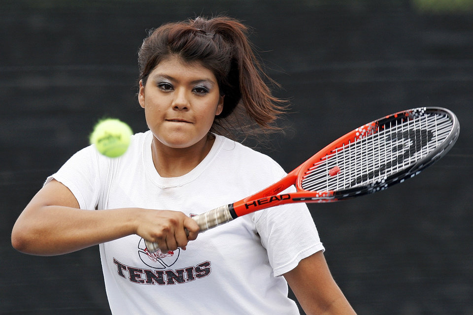 Photo - Claremore's Samantha Chavez competes in a Class 5A #1 Doubles match during the girls state high school tennis tournament at the Oklahoma City Tennis Center in Oklahoma City, Friday, May 4, 2012. Photo by Nate Billings, The Oklahoman