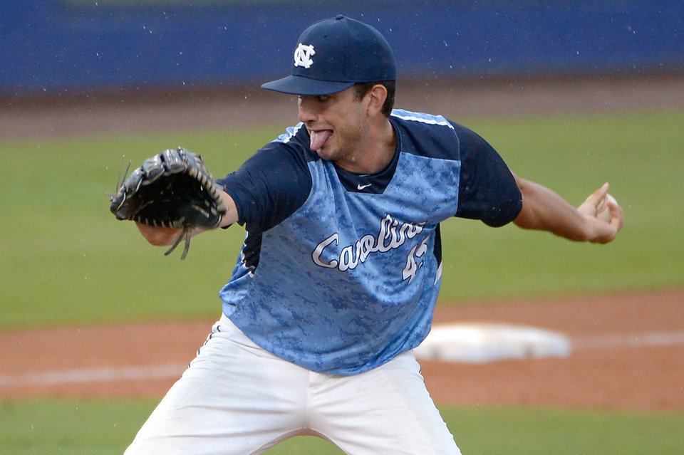 Photo - North Carolina pitcher Zach Rice throws to home plate during the seventh inning of an NCAA college baseball regional tournament game against Long Beach State in Gainesville, Fla., Sunday, June 1, 2014. (AP Photo/Phelan M. Ebenhack)