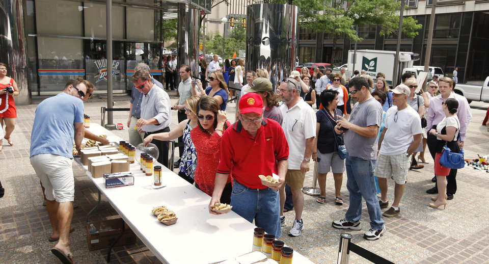 Photo - People line up to buy fresh grilled tacos at Leadership Square during the OK Chefs Relief pop, which benefitted the ongoing recovery efforts in local storm-torn communities.  PAUL B. SOUTHERLAND - PAUL B. SOUTHERLAND