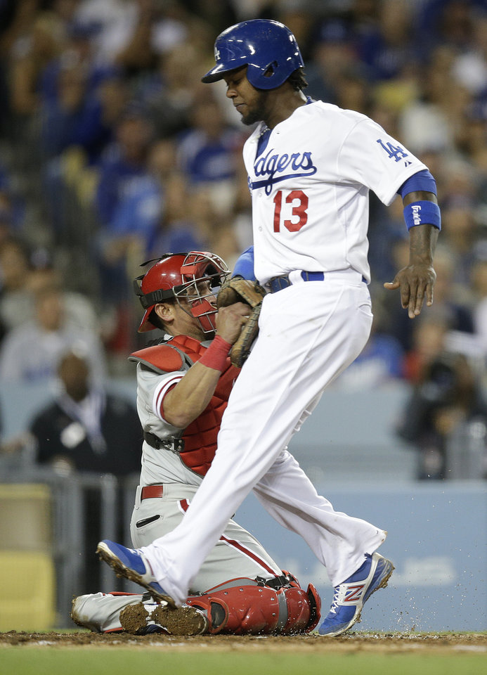 Photo - Los Angeles Dodgers' Hanley Ramirez is tagged out by Philadelphia Phillies catcher Carlos Ruiz as he tries to score on a ground ball hit by Yasiel Puig during the fifth inning of a baseball game Thursday, April 24, 2014, in Los Angeles. (AP Photo/Jae C. Hong)