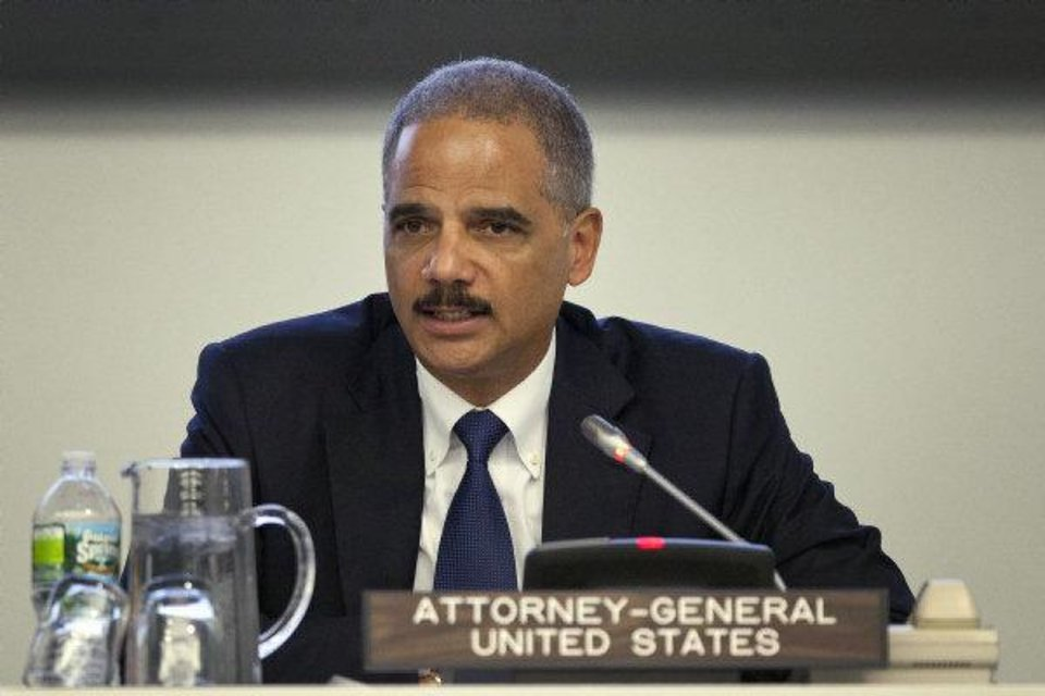Photo - U.S. Attorney General Eric Holder  Andrew Burton - AP