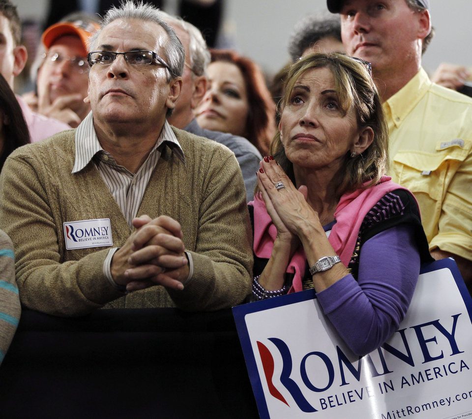 Photo -   Audience members listen as Republican presidential candidate, former Massachusetts Gov. Mitt Romney campaigns at the Emma Lou Olson Civic Center, in Pompano Beach, Fla., Sunday, Jan. 29, 2012. (AP Photo/Charles Dharapak)