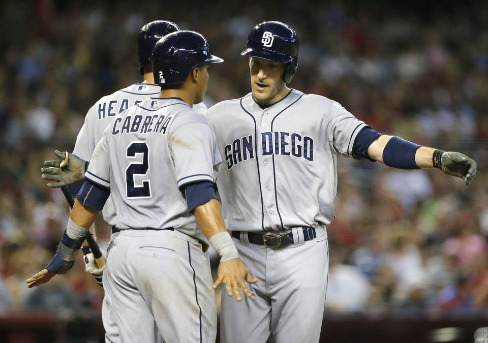 Photo - San Diego Padres' Chris Denorfia, right, celebrates his two-run home run with Everth Cabrera (2) during the fourth inning of a baseball game against the Arizona Diamondbacks, Saturday, July 27, 2013, in Phoenix. (AP Photo/Matt York)