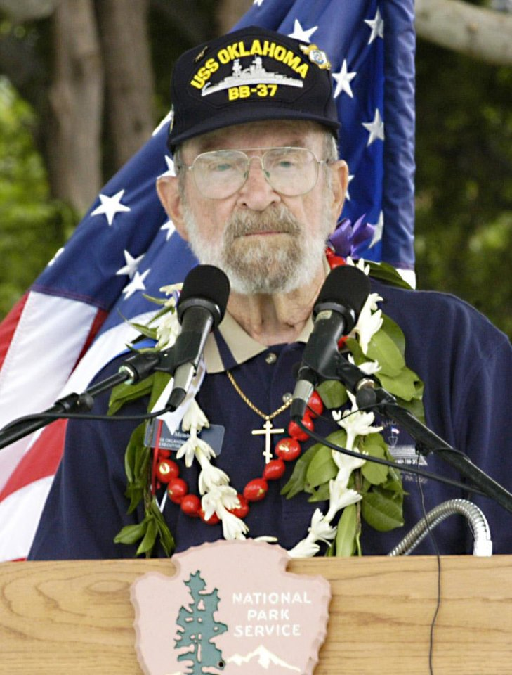 Photo - Ed Vezey, of Moore, a survivor of the Dec. 7, 1941, attack on Pearl Harbor, speaks at a commemoration of the event in Hawaii. He wears a cross in memory of Francis