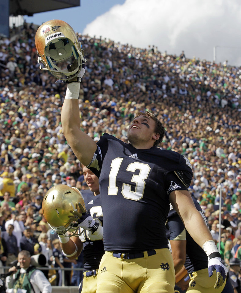 FILE - In this Sept. 8, 2012 file photo, Notre Dame linebacker Danny Spond (13) cheers during the first half of an NCAA college football game against Purdue in South Bend, Ind. The junior from Littleton, Colo., wasn't sure he'd play football again after he was struck by a debilitating migraine headache that left him barely able to move because the left side of his body was so numb. But after missing the first two games, Spond has bounced back and started eight games for the third-ranked Fighting Irish heading into Saturday's game against Wake Forest.(AP Photo/Michael Conroy, File)