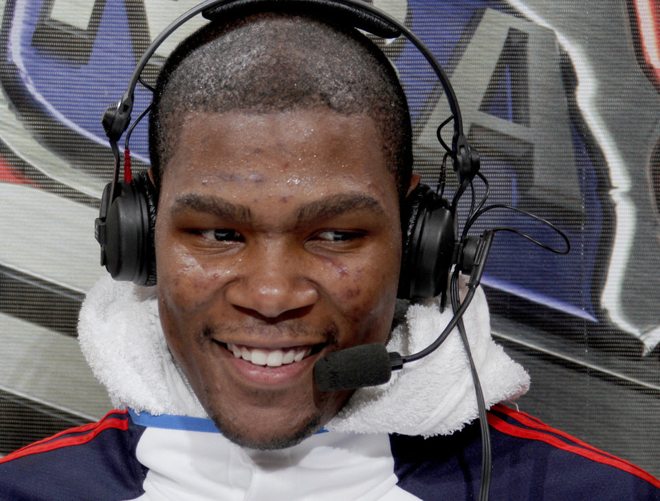 Photo - Oklahoma City's Kevin Durant smiles during an interview after the NBA basketball game between the Oklahoma City Thunder and the Memphis Grizzlies at the Ford Center in Oklahoma City on Wednesday, April 14, 2010. 