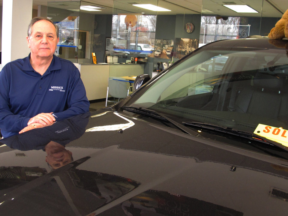 Joe Settineri , owner of Merrick Dodge Chrysler Jeep of Wantagh, N.Y., stands beside a recently sold Jeep. The car dealer says sales have been extraordinary in the weeks since Superstorm Sandy, as thousands of people are trying to replace vehicles damaged in the storm.(AP Photo/Frank Eltman)